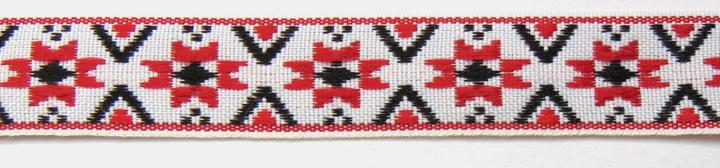 Българска народна шевица с транслация и две отражения – вертикално и хоризонтално.